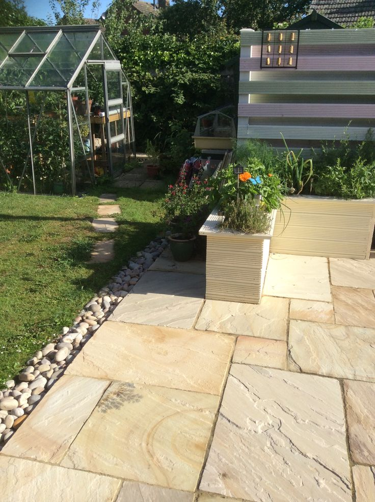 Love the use of stones as a border between the patio and the lawn