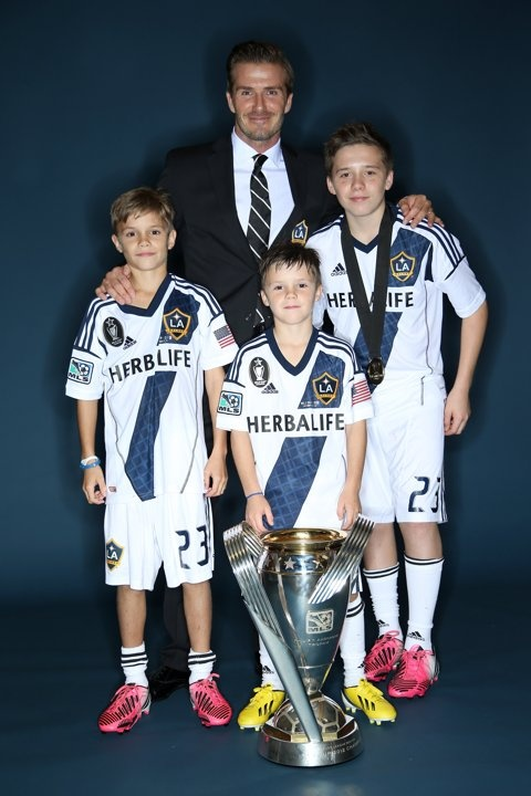 9CARSON, CA - DECEMBER 01: David Beckham of the Los Angeles Galaxy poses with his sons, left to right, Romeo, Cruz and Brooklyn after the Los Angeles Galaxy won the 2012 MLS Cup 3-1 against the Houst