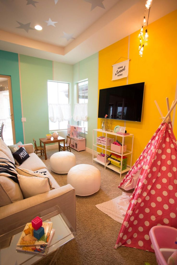 Fun details like gradient color on the walls and painted stars on the ceiling create a playroom with panache