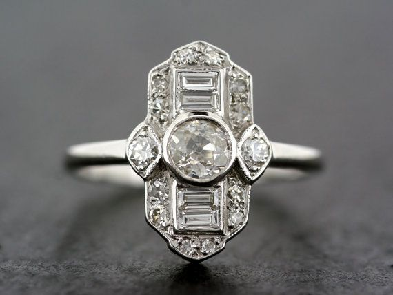 Hey, I found this really awesome Etsy listing at https://www.etsy.com/listing/226178479/art-deco-engagement-ring-antique-diamond