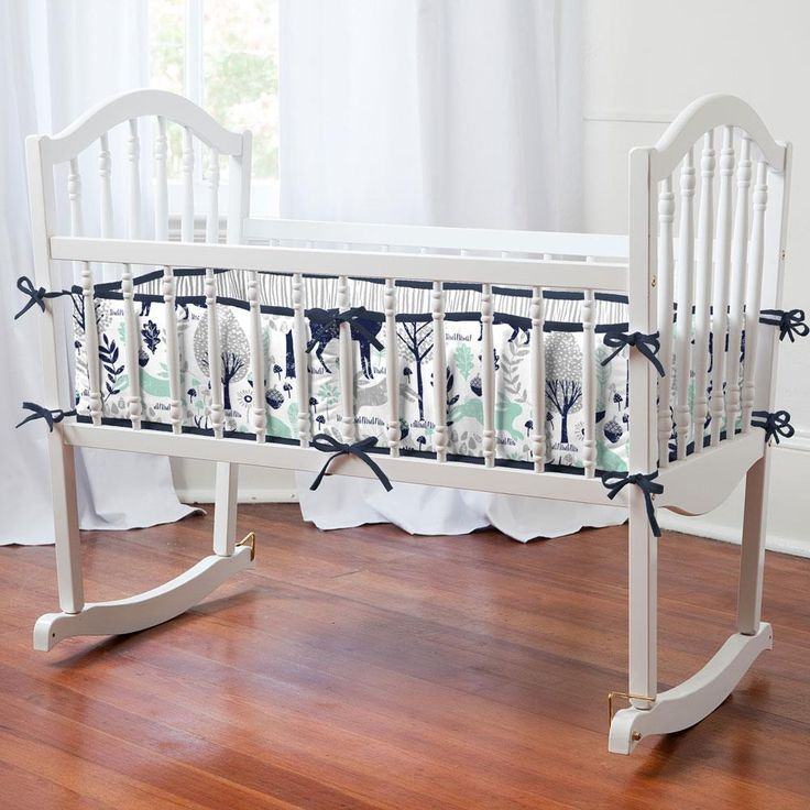 Navy and Mint Woodlands Cradle Bedding by Carousel Designs.