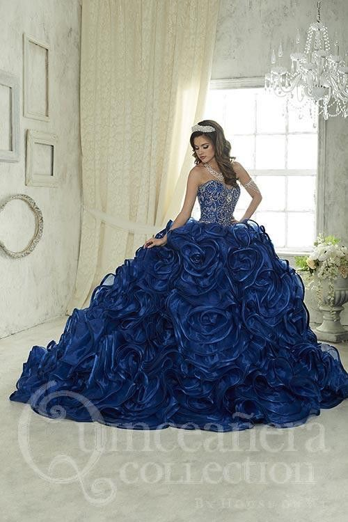 Illuminated by shining, colorful beads on its sweetheart bodice, this gown has organza, rosette ruffles pouring from its waistline, edged by satin, with some ruffles stitched with a silvery thread for