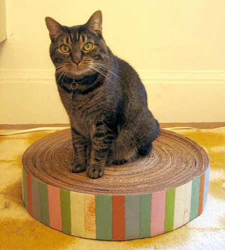 DIY Recycled Cardboard Cat Scratcher... we made this one and it worked. Add a little catnip and the kitties come running.  Though after awhile my little fur babies just liked to sleep on it, they did use it as a scratcher occasionally too.