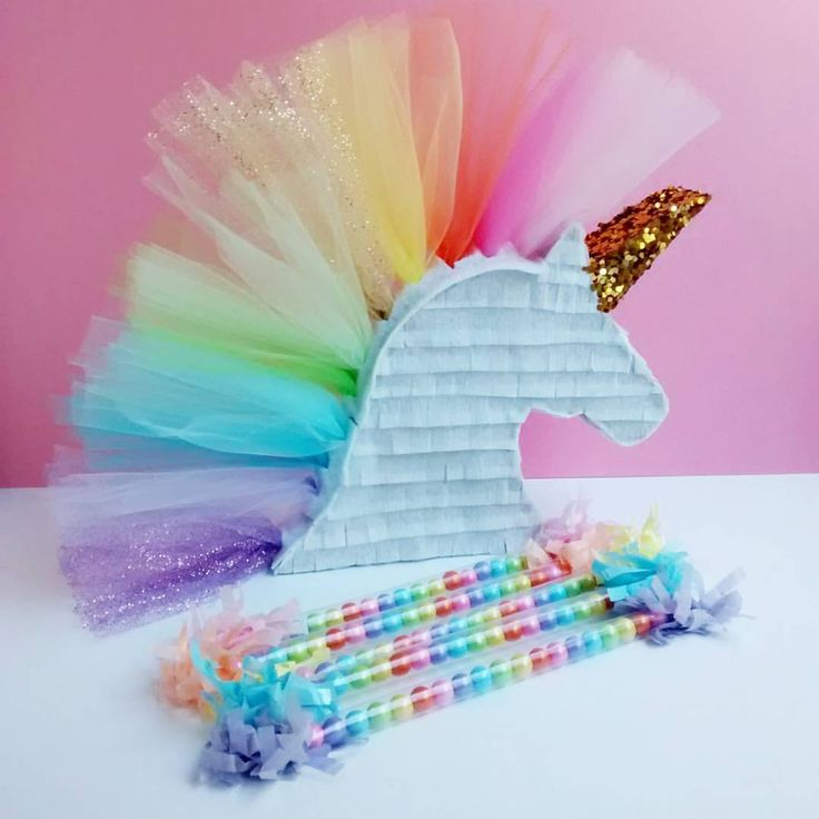 Oh, how I never get tired of this beauty!  A rainbow tulle unicorn pinata brings a touch of magic and fairytale dreams to any little girl's party or bedroom decor.