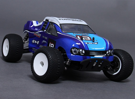 Equipped with an 18A brushless power system, this little 1/18 truck is very quick on carpet and roads.  It's small size means you can zip around your house on as little as a 2S LiPo pack.  The 1/18 truck has a brushless inrunner motor and esc pre-installed along with a high-torque steering servo. All you need to do is include your own Receiver and LiPo battery!  This is not a high-performance monster truck, but it is a huge amount of fun indoors and out!
