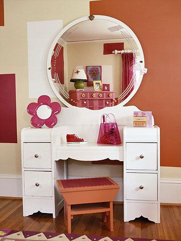 Get Pretty - A child-size dressing table is one of many repainted vintage finds that have come together to create a striking girl's room. With such large, graphic blocks on the wall, artwork is kept to a minimum, letting the contrast of the circular mirror and rectangular shapes stand out.