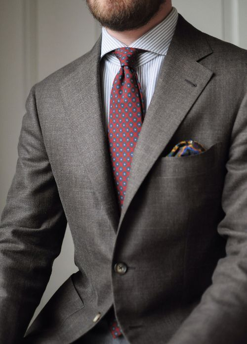 Chique tie with non-matching, yet fitting, pocket square.