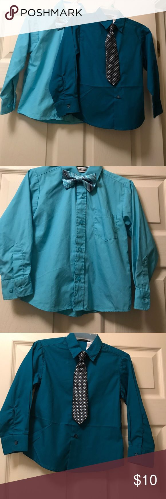2 like new boys dress shirts with clip on ties Great for a special occasion!2 like new boys dress shirts both size 7.light blue is Van Heiden with bow tie and dark blue is holiday editions with clip on tie. Only used once each Van Heusen Shirts & Tops Button Down Shirts
