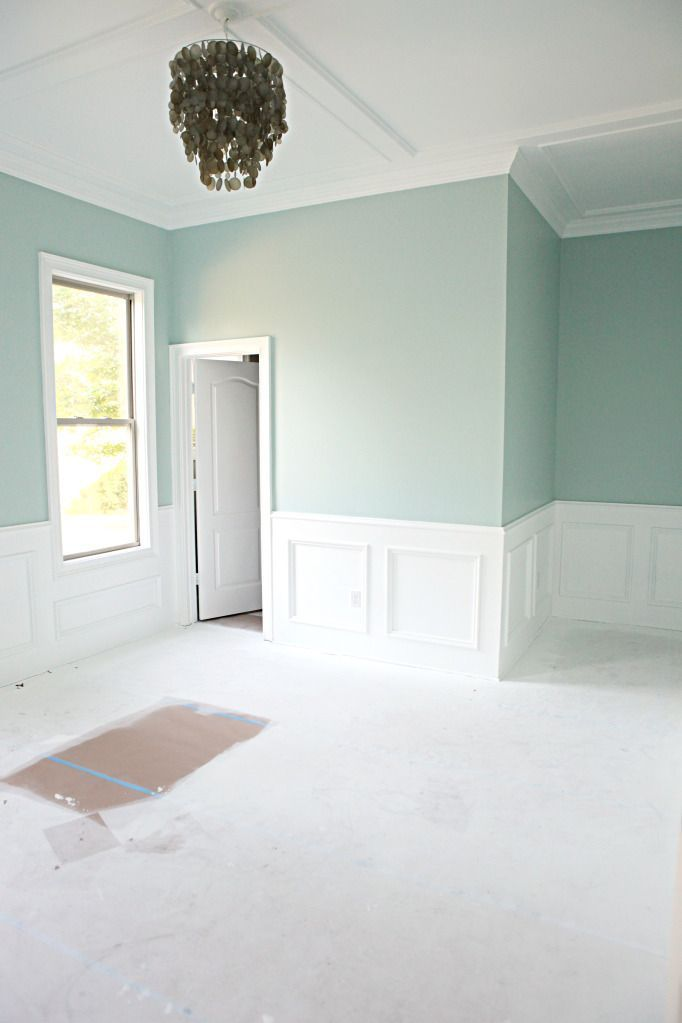 Benjamin Moores Palladian Blue. Its a great muted but still slightly vibrant greenish blue- looks great in this light