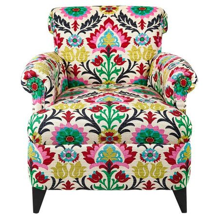 this eye-catching arm chair brings colorful appeal to your living room or home library.