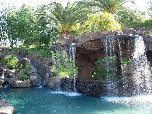waterslide and the jacuzzi that is a waterfall into the pool