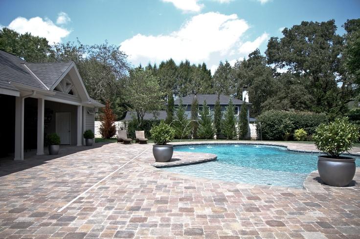 belgard pavers used around pool and patio area.   swimming pools