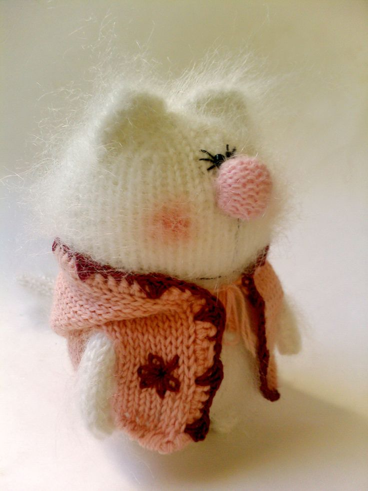 This fancy amigurumi kitty is hand-knitted from fuzzy natural white mohair. It comes in a nice pink jacket with hood (jacket can be removed). Jacket is knitted from woolen yarn. The hoodie can be swapped with other characters. Cat is stuffed with non-allergic holofiber. It will arrive to you packed in a custom brown bag.  Kitty is about 12 cm tall - 4.7 inches  PLEASE NOTE, TOY IS NOT SUITABLE FOR SMALL CHILDREN. RECOMMENDED AGE 5+