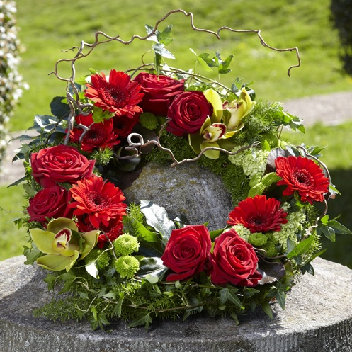 Beautiful grouped wreath in reds and lime greens.