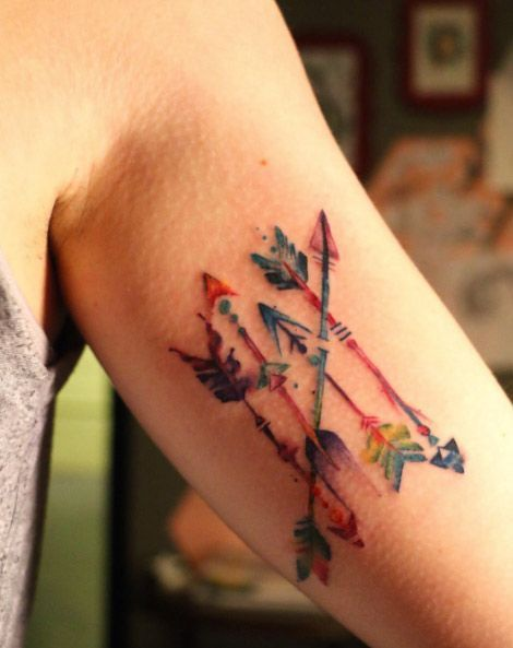 Most people who get arrow tattoos prefer something simple in black ink. If you want something different, try getting a color version of multiple arrows. It would look a lot more fun and a more creative approach to arrow tattoos.