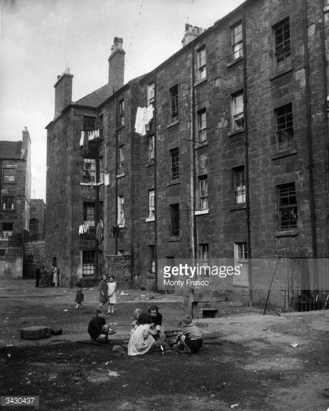 Children play on waste ground outside a tenement block in Camden Street, the Gorbals, Glasgow. The tenements were built quickly and cheaply in the 1840's and are owned by various landlords. About...
