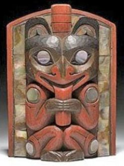 A Northwest Coast Frontlet Painted In Red And Brown Carved With Seated Bear