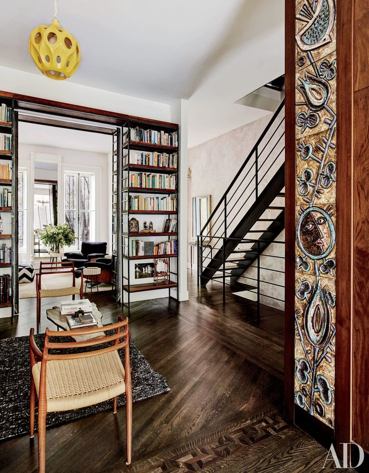 Rostagno merged two duplex apartments with the help of architects Robin Elmslie Osler and Ken Levenson. A minimalist steel staircase with reclaimed-oak steps designed by Osler overlooks the sitting area; the shelves are by Benjamin Bajorek, and the ceramic-tile frieze at right is by Giovanni Vettori.