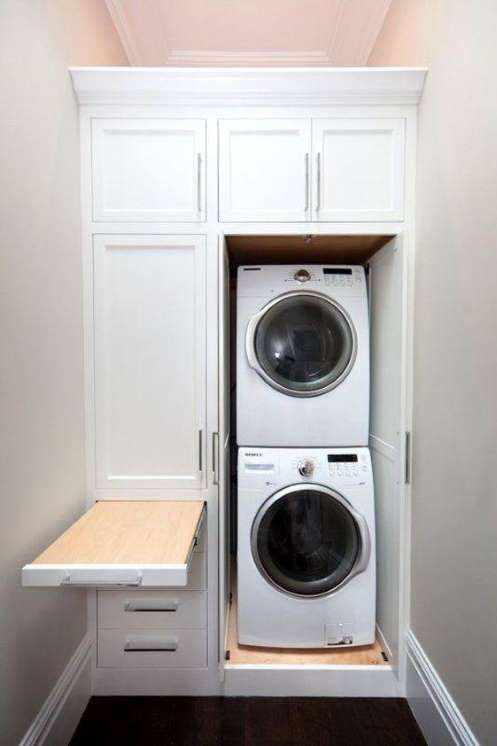 This stacker washer and dryer set wastes no space. The surrounding cabinetry disguises the laundry s... - Via Pinterest/Apartment Therapy