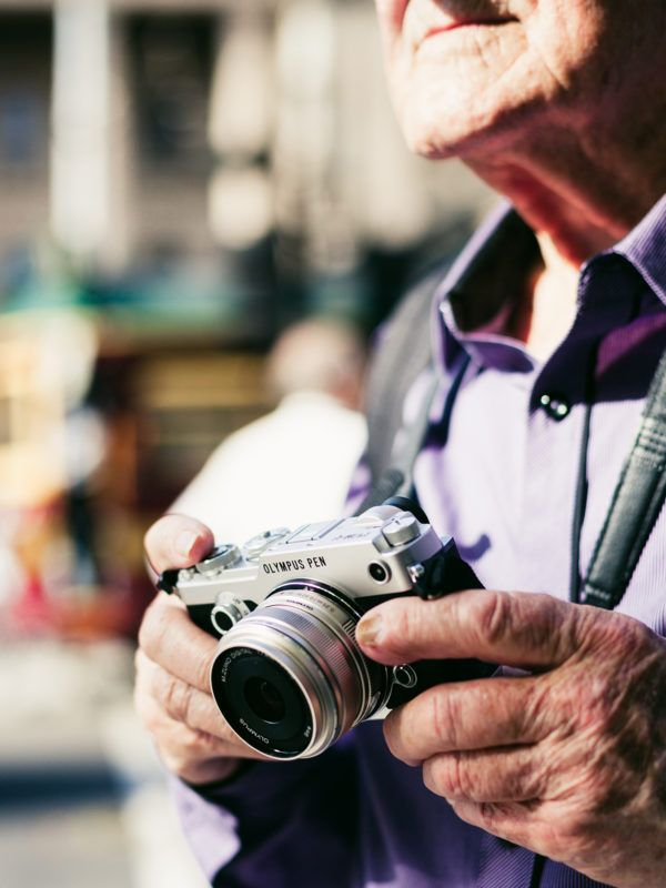 Angus O'Callaghan on assignment, with the Olympus PEN-F. Photo – Amelia Stanwix.