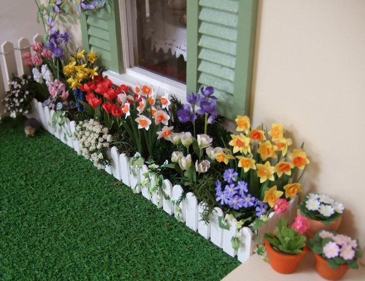 spring flower kits, filler, and cute white picket bed