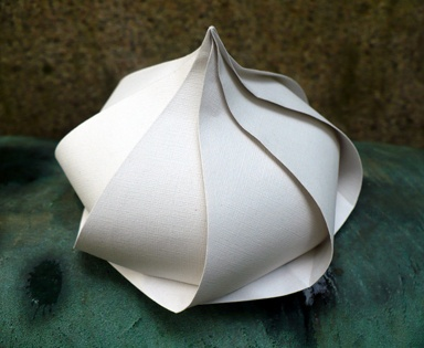 GARLIC IS ART:  A garlic bulb is a natural beauty, but it's also a perfect subject for the arts. This is a tato box or self-closing origami container.