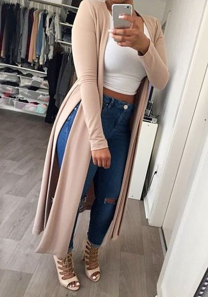 Angled view of girl in light tuscan longline cardigan