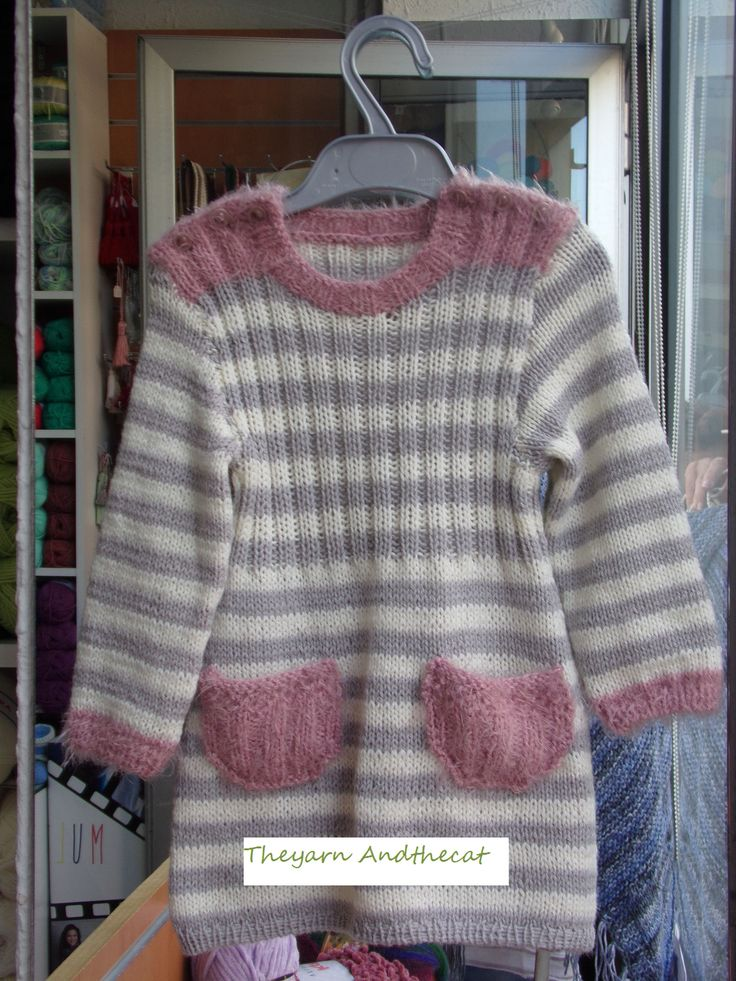 Fine striped baby dress with  soft yarn, 50% wool, 50% acrylic. It is decorated with pink thread like fur. Age 2 years.