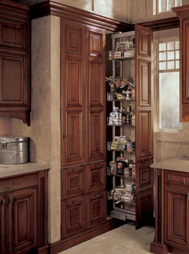 If you don't have a separate room for a larder, convert your cabinets into a built-in pantry. Choose a custom version like the one shown here to blend in with your cabinetry.