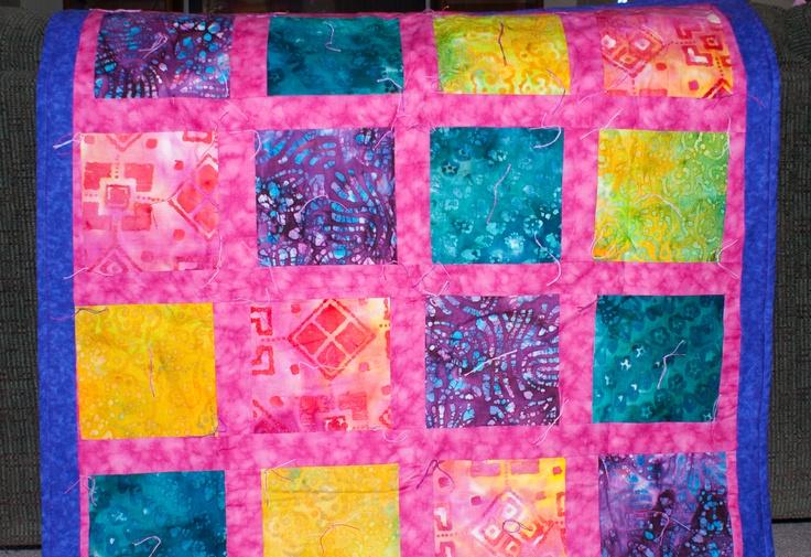Colorful batik lap quilt.