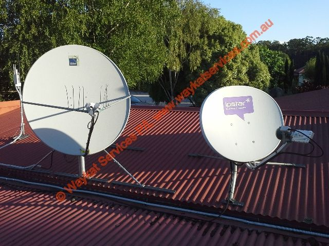 2 x of the telecommunications satellite dishes that Waykat Services have been involved in that service the business for internet the 1 on the right hand side an I.P. star satellite dish & the 1 on the left hand side an NBN Co. satellite dish.  In the background and to the left hand side of the NBN Co. dish you can see the Ubiquiti Unifi Outdoor WiFi access point that makes up part of the segmented WiFi service available to both staff and guests.