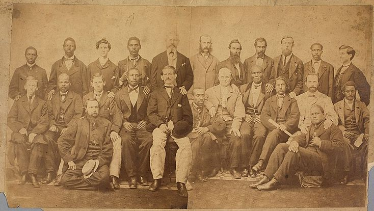 The 24 members of the petit  jury impaneled by the United States Circuit Court for Virginia in Richmond for Davis' trial for treason in May 1867.    A jury of 12 African American and 12 Anglo American men was recruited by United States Circuit Court judge John Curtiss Underwood in preparation for the trial.    Contemporary composite image from two glass plate negatives.