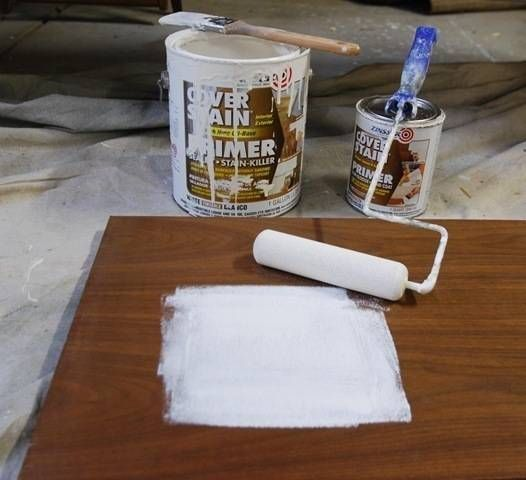 zinsser oil based primer  -paint laminate with no sanding, just scuff it up and wipe clean http://www.centsationalgirl.com/2010/11/credenza-practical-meets-pretty/