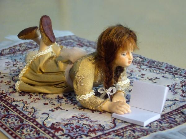 'Girl reading on a rug' by Cristina Caballero.1/12th scale. (would love her for my dolls house)
