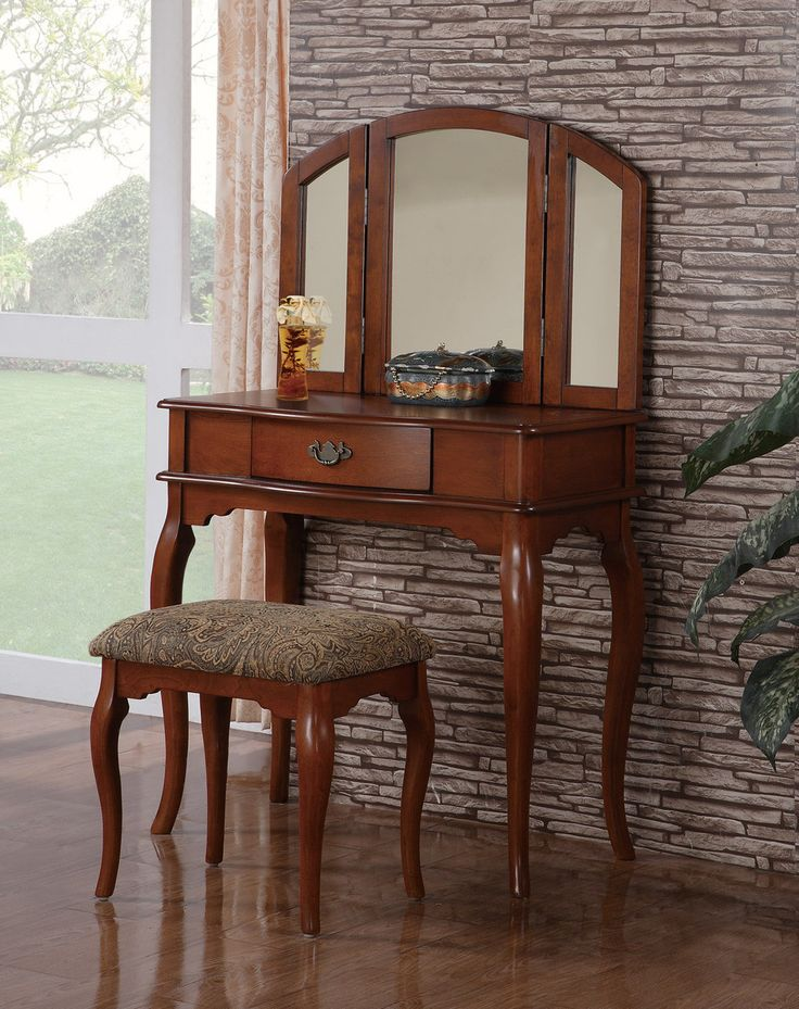Vanity w/ Stool F4068An enchanting style of dainty décor, This vanity set collection features a mirror with attached moveable extensions and a single-drawer table for storage and accessory display.  Vanity Set Sale for $335