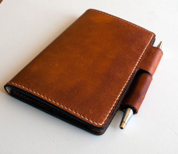 A completely handmade item from cutting the leather , dying to hand stitching and burnishing the edges. The leather is a high quality full grain