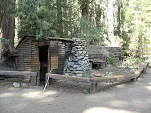 Sequoia National Park - Tharp's Log, a cabin formed out of a hollowed-out Giant Sequoia log.