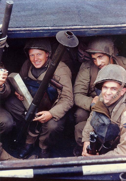 US Army Rangers awaited the invasion signal in a landing craft in an English port, circa early Jun 1944, photo 1 of 2; note the bazooka and the M1 Garand rifles.