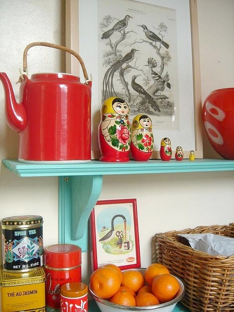Babushka dolls by J. Hodgette.  Great look for kitchen shelves.