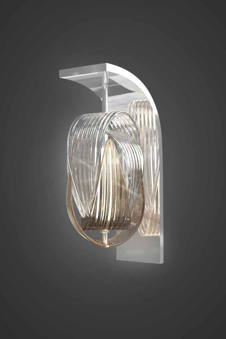 A wall lamp from the Babel lighting collection by @jirikrisica. It is made of hand-blown parachute components requiring extraordinary skill and the utmost precision of the glass-maker. The Babel light fixture is attractive as a small or large cluster or a couple of solitary pendants.