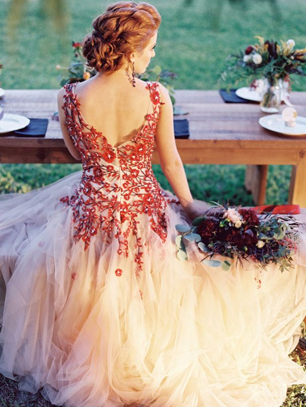Pretty red wedding dress with hints of marsala in the dress and the bride's bouquet!