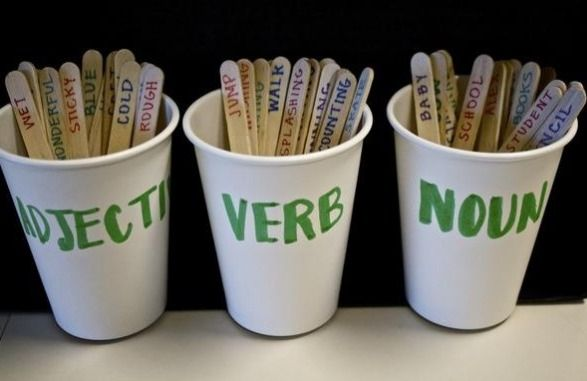 Cool cups to keep in the classroom with paddle pop sticks for examples of adjectives, verbs and nouns. Students could help to create the examples with the teacher.
