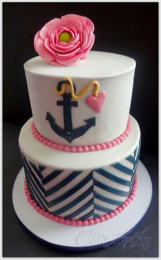 Modern chevron nautical cake with pink ranunculus.
