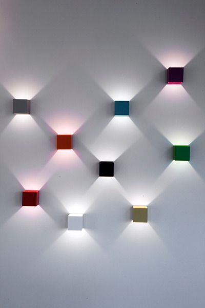 Lux Wall Lamp by Lighthouse-  This wall lamp can rotate 360 degrees, so you change change the light direction any time you feel like it.  Fun colors and fun light effects!