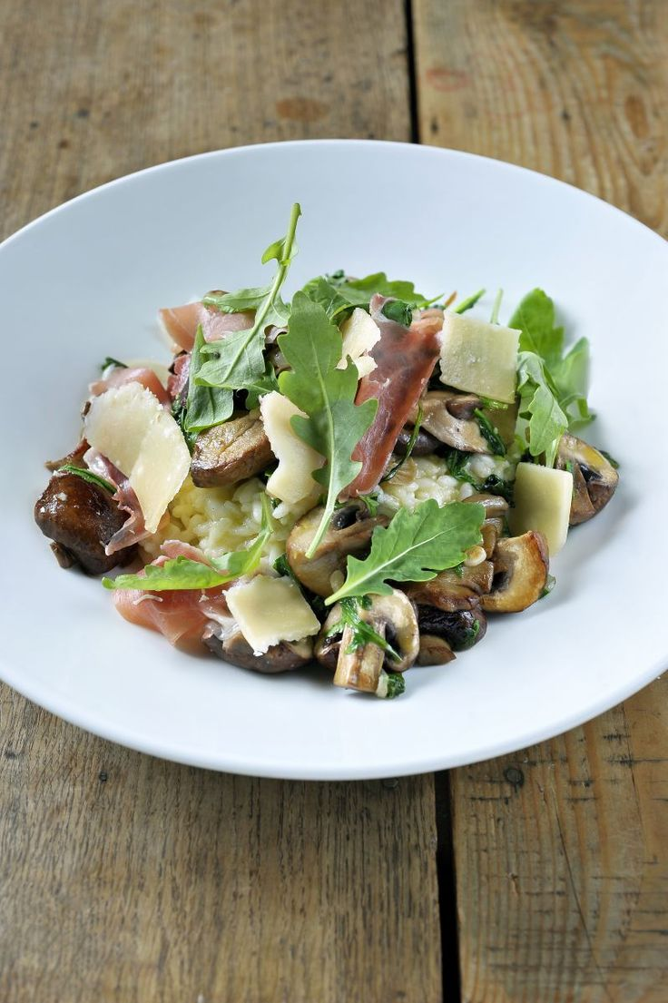 Risotto met bospaddenstoelen en rucola