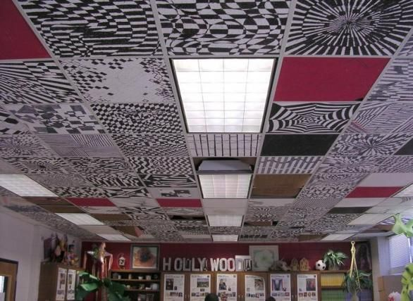 Pupils in Christina Mode's art class at Tutt Middle School have painted the ceiling with their own black-and-white designs. The tiles were taken down, painted and then replaced in the ceiling.  C. Samantha McKevie/Staff