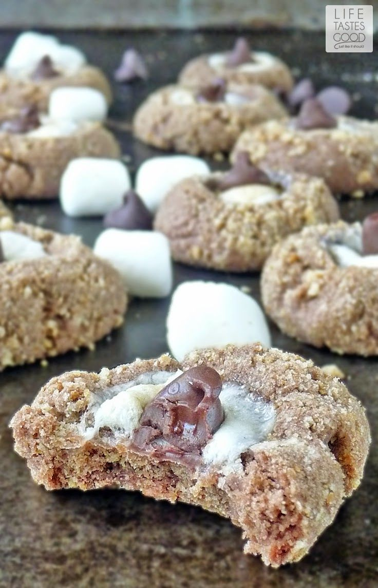 S'more Cookie Recipe   by Life Tastes Good   Fun chocolate cookies rolled in graham cracker crumbs and topped with a mini marshmallow. All the flavors of a traditional s'more rolled into an easy-to-make cookie. No open fire required!