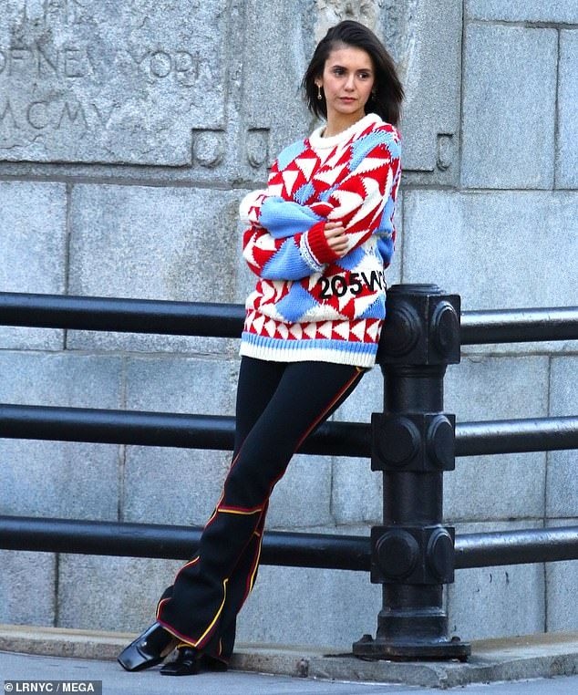 80ccbee48fc Nina Dobrev dons festive winter sweater and tight black leggings ...