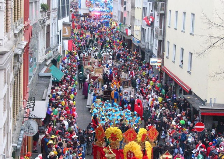 """Rose Monday in Cologne. The Karneval season begins at 11 minutes past the eleventh hour on the 11th of November and the """"street carnival"""" starts on the Thursday before Rosenmontag, which is known as Weiberfastnacht (""""women's carnival"""")."""