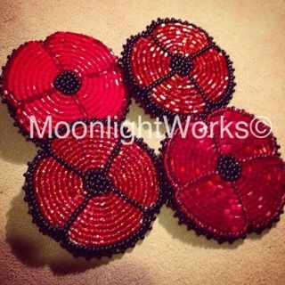 The poppy has a long association with Remembrance Day. The poppy came to represent the immeasurable sacrifice made by soldiers and quickly became a lasting memorial to those who died in World War One and later conflicts. A portion of each sale of a beaded poppy will be donated to a veterans charity or organization. Honour the fallen with this beautiful long lasting beaded poppy made with seed beads and glass cut beads, and a durable clasp back pin sewn under black leather. Specifics: H...